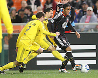 Andy Najar#14 of D.C. United is challenged by Rich Balchan#2 and Dejan Rusmir#22 of the Columbus Crew during the opening match of the 2011 season at RFK Stadium, in Washington D.C. on March 19 2011.D.C. United won 3-1.