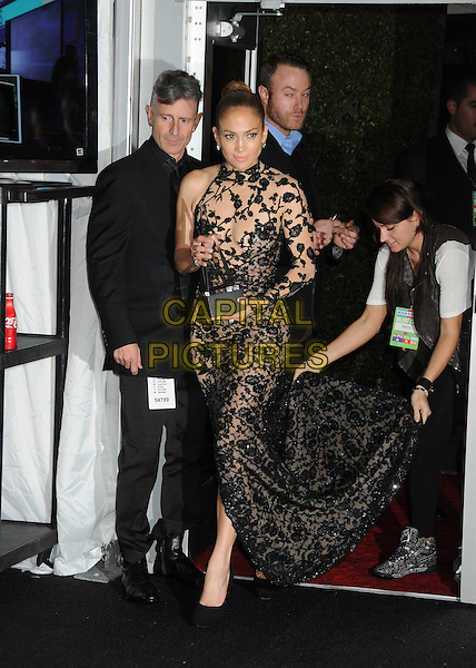 Jennifer Lopez.2011 American Music Awards - Press Room held at Nokia Theatre LA Live, Los Angeles, California, USA..November 20th, 2011.ama amas ama's full length black dress sheer lace one sleeve train lifting trophy winner .CAP/ADM/BP.©Byron Purvis/AdMedia/Capital Pictures.