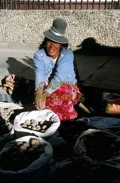 Lady selling vegetables in the roadside market, Puno, Peru