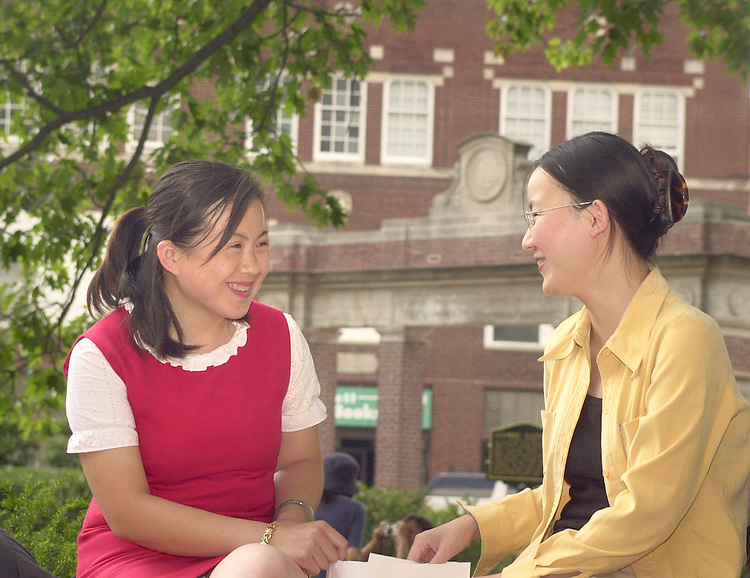 16557Summer Campus Photos.Wang Huijun, left and Yuxia Qia, right talk on college green