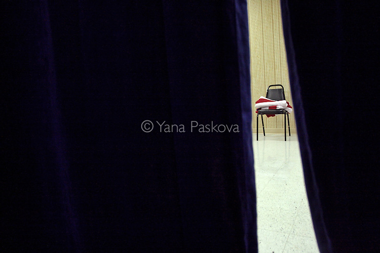 An American flag lays folded on a chair backstage as U.S. Presidential hopeful Hillary Clinton (D-NY) speaks at the Bluegrass Cafe in Tama, IA, on Nov. 19, 2007.