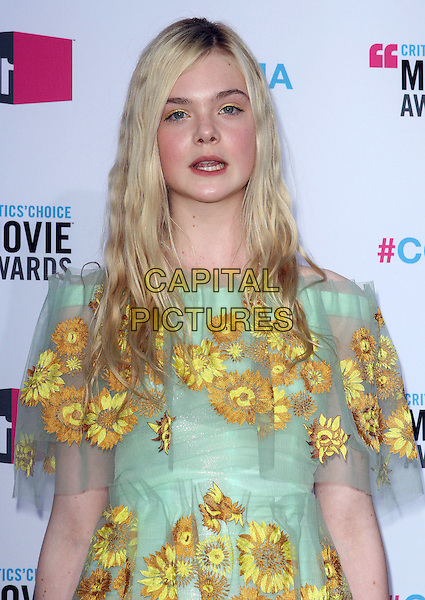 Elle Fanning.17th Annual Critics Choice Movie Awards held at the Hollywood Palladium, Los Angeles, California, USA..January 12th, 2012.half length green yellow floral print dress sheer mouth open.CAP/ADM/KB.©Kevan Brooks/AdMedia/Capital Pictures.