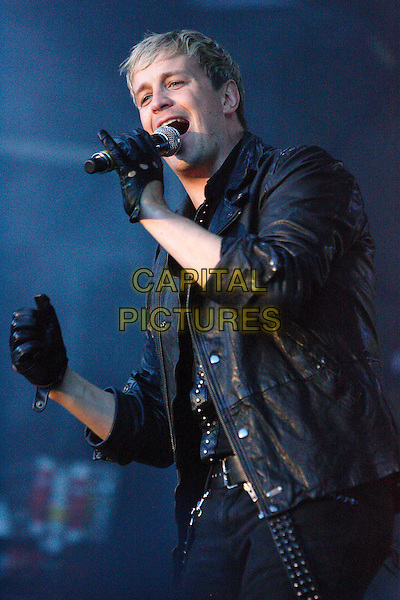 WESTLIFE - Kian Egan.Midlands Music Festival at Tamworth Castle, Staffordshire, USA, .July 18th 2010..live on stage concert gig half length black shirt gloves leather microphone studded jacket .CAP/ROS.©Steve Ross/Capital Pictures