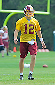 Washington Redskins back-up quarterback Kirk Cousins (12) participates in passing drills during the 2013 minicamp at Redskins Park in Ashburn, Virginia on Wednesday, June 12, 2013.<br /> Credit: Ron Sachs / CNP