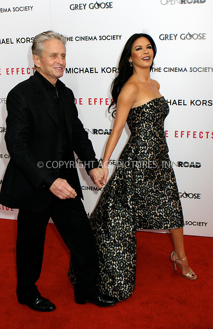 WWW.ACEPIXS.COM....January 31 2013, New York City........Michael Douglas and Catherine Zeta-Jones arriving at the premiere of 'Side Effects' at AMC Lincoln Square Theater on January 31, 2013 in New York City....By Line: Nancy Rivera/ACE Pictures......ACE Pictures, Inc...tel: 646 769 0430..Email: info@acepixs.com..www.acepixs.com