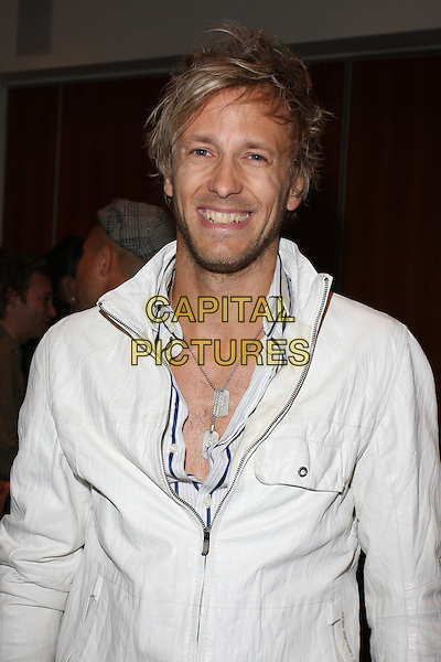 RICK PARFITT JR. .UK Premiere of 'Baseline' at BAFTA Piccadilly, London, England, UK, .June 29th 2010.half length white jacket smiling necklace silver dog tag hairy chest  beard facial hair .CAP/ROS.©Steve Ross/Capital Pictures