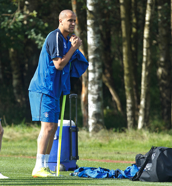 Madjid Bougherra leaning on a pole at training