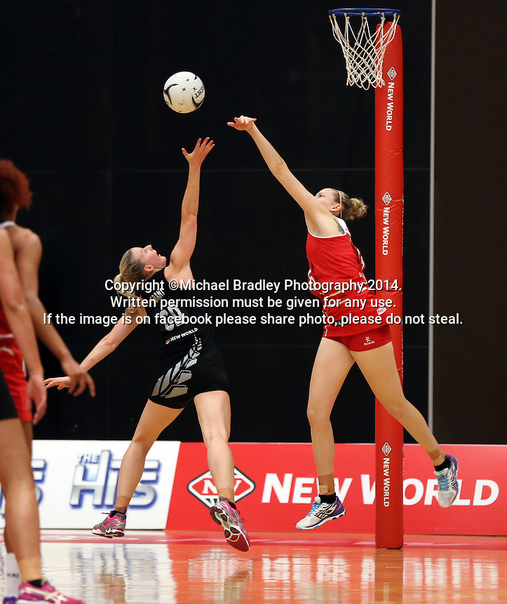 28.10.2014 Silver Ferns Katrina Grant and England's Jo Harten in action during the Silver Ferns V England netball match played at the Rotorua Events Centre in Rotorua. Mandatory Photo Credit ©Michael Bradley.