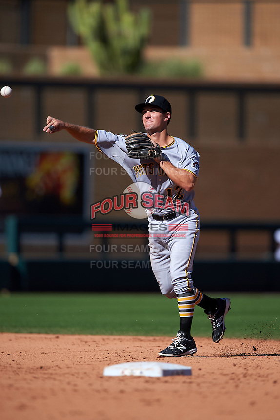 Glendale Desert Dogs shortstop Adam Frazier (12) throws to first during an Arizona Fall League game against the Surprise Saguaros on October 23, 2015 at Salt River Fields at Talking Stick in Scottsdale, Arizona.  Glendale defeated Surprise 9-6.  (Mike Janes/Four Seam Images)