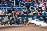 Michigan Wolverines designated hitter Jordon Nwogu (42) slides into third base as Vanderbilt Commodores third baseman Austin Martin (16) applies the tag during Game 1 of the NCAA College World Series Finals on June 24, 2019 at TD Ameritrade Park in Omaha, Nebraska. Michigan defeated Vanderbilt 7-4. (Andrew Woolley/Four Seam Images)