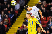 Everton's forward Dominic Calvert-Lewin (9) for England U21's  challenges Valencia CF Mestalla's defender Ivan Zotko (13) for Ukraine U21's  for the ball during the International Euro U21 Qualification match between England U21 and Ukraine U21 at Bramall Lane, Sheffield, England on 27 March 2018. Photo by Stephen Buckley / PRiME Media Images.