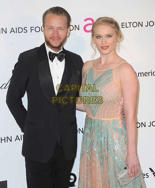 guest & Leven Rambin.The 21st Annual Elton John AIDS Foundation Academy Awards Viewing Party held at The City of West Hollywood Park in West Hollywood, California, USA..February 24th, 2013.oscars half length dress black tuxedo white shirt beard facial hair blue pink pattern .CAP/DVS.©DVS/Capital Pictures.