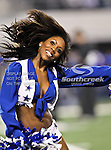 The Dallas Cowboys cheerleaders in action during the Thanksgiving Day game between the Miami Dolphins and the Dallas Cowboys at the Cowboys Stadium in Arlington, Texas. Dallas defeats Miami 20 to 19....