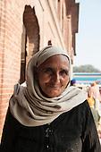 Amritsar, Punjab, India. A smiling woman worshipper with headscarf at the Sri Harmandir Sahib Golden Temple.