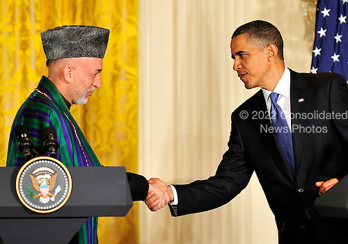 United States President Barack Obama, right, shakes hands with President Hamid Karzai of Afghanistan, left, during a joint press conference in the East Room of the White House in Washington, DC on Wednesday, May 12, 2010..Credit: Ron Sachs / CNP