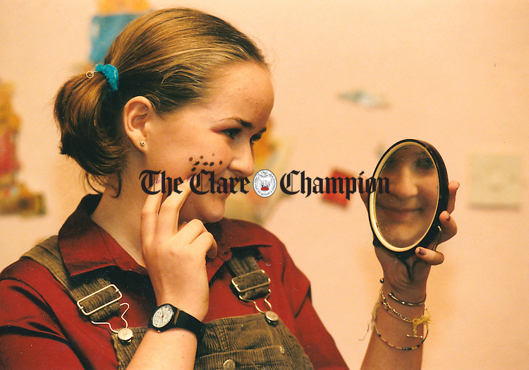 Eithne Barry, Banner GAA Club, checking her makeup before taking to the stage at the Scór na nÓg finals at Cois na hAbhna - December 24, 1999. Photograph by Eamon Ward