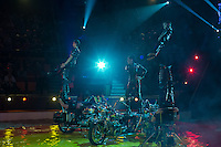 Artists of team Ikaria from Ukraine perform on their motorbikes with dogs and lamas during the premiere of the new show titled Lights of the Universe in Budapest, Hungary on October 05, 2013. ATTILA VOLGYI