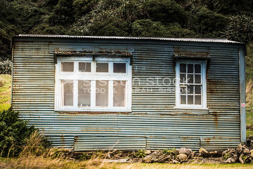 Old bach, Ocean Beach, Wairarapa Coast, New Zealand - stock photo, canvas, fine art print