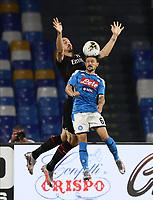 12th July 2020; Stadio San Paolo, Naples, Campania, Italy; Serie A Football, Napoli versus AC Milan; Mario Rui of Napoli wins the header from Zlatan Ibrahimovic of AC Milan