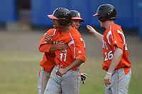 Bowling Green Falcons Brian Bien (3), Brandon Howard (11) and Cody Gallaway (26) celebrate a run during a game against the Illinois State Redbirds on March 11, 2015 at Chain of Lakes Stadium in Winter Haven, Florida.  Illinois State defeated Bowling Green 8-7.  (Mike Janes/Four Seam Images)