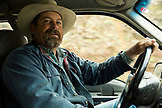 USA, Oregon, Enterprise, Cowboy and Rancher Todd Nash drives his truck past Joseph into the Canyon to move cattle up Big Sheep Creek