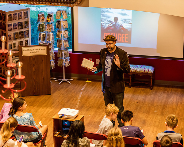 July 26, 2017. Raleigh, North Carolina.<br /> <br /> Alan Gratz reads from his new book &quot;Refugee&quot;.<br /> <br /> Author Alan Gratz spoke about and signed his new book &quot;Refugee&quot; at Quail Ridge Books. The young adult fiction novel contrasts the stories of three refugees from different time periods, a Jewish boy in 1930's Germany , a Cuban girl in 1994 and a Syrian boy in 2015.