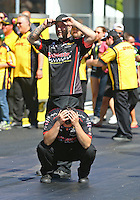 May 15, 2016; Commerce, GA, USA; Crew members for NHRA top fuel driver J.R. Todd react after losing in the final round of the Southern Nationals at Atlanta Dragway. Mandatory Credit: Mark J. Rebilas-USA TODAY Sports