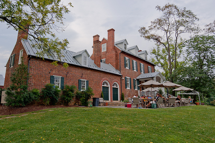 Groups enjoy picnics and their wine on the front patio at The Winery at La Grange.