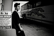 Robert Bordelon, 19, waits to board a bus to Dallas after being released from the Texas State Penitentiary in Huntsville, Texas.