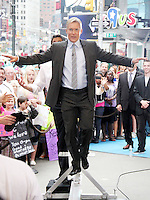 June 13, 2012 Sam Champion on the balance beam during a segment on Good Morning America in New York City. © RW/MediaPunch Inc. NORTEPHOTO.COM<br />