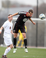 Conor Shanosky (17) of D.C. United heads away from Brian Ownby (9)  during a scrimmage against the University of Virginia at Ludwig Field, University of Maryland, College Park, on April  10 2011. D.C. United won 1-0.