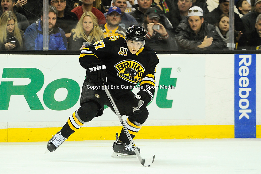 January 2, 2014 - Boston, Massachusetts, U.S. - Boston Bruins defenseman Torey Krug (47) plays the puck during the NHL game between Winnipeg Jets and the Boston Bruins held at TD Garden in Boston Massachusetts.  Boston defeated Winnipeg 4-1 in regulation. Eric Canha/CSM