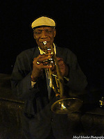 Lino plays trumpet on the Malecon in Havana, Cuba at 1am -Photo by Meryl Schenker