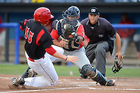 State College Spikes catcher Alex De Leon (53) blocks the plate to tag out Chad Wallach (55) sliding in as umpire Nate Caldwell gets in position to make the call during a game against the Batavia Muckdogs on July 29, 2013 at Dwyer Stadium in Batavia, New York.  State College defeated Batavia 2-1.  (Mike Janes/Four Seam Images)