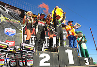 Apr 16, 2011; Surprise, AZ USA; LOORRS driver Rick Huseman (center) on the podium with Kyle Leduc (left) and Adrian Cenni following round 3 at Speedworld Off Road Park. Mandatory Credit: Mark J. Rebilas-.