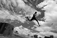 A Colombian parkour runner performs a high jump during a free running training exercise of Tamashikaze team in a park in Kennedy, Bogotá, Colombia, 21 February 2016. Parkour, originally developed in France during the late 1980s from military training, is a physical activity, focused on the art of movement and overcoming obstacles in a strictly urban environment. Practitioners of parkour employ running, climbing, jumping, rolling and other movements to pass through any urban area the most efficient way possible.