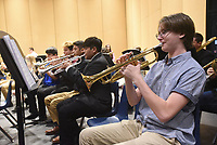 NWA Democrat-Gazette/FLIP PUTTHOFF <br /> CONCERT FINALE<br /> Aurick Schmidt plays trumpet Saturday May 11 2019 with the Rogers High School concert band during warm-ups before the end of year concert in the auditorium. The school's concert band and symphonic band performed during the concert. An awards banquet followed the music.
