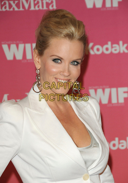 JENNY McCARTHY .at The Women in Film 2009 Crystal .and Lucy Awards held at The Hyatt Regency Century Plaza in Century City, California, USA, June 12th 2009                                                                     .portrait headshot hair up earrings silver hoops dangly white suit jacket shoulder pads .CAP/DVS.©DVS/RockinExposures/Capital Pictures