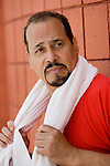 Mature hispanic man looking concerned
