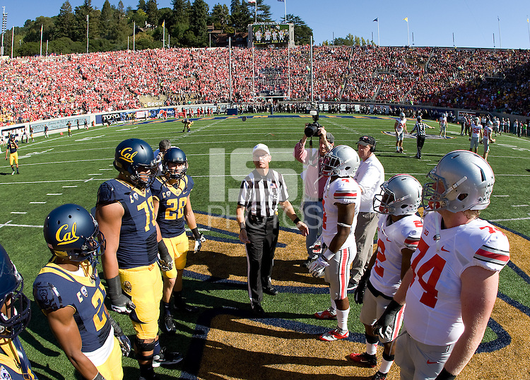 California and Ohio State captains watch referee Jay Stricherz toss the coin before the game at Memorial Stadium in Berkeley, California on September 14th, 2013.  Ohio State defeated California, 52-34.
