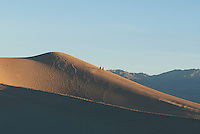 Hikers on the Mesquite Flat sand dunes, Death Valley National Park, California