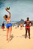 BRAZIL, Rio de Janiero, Pele de Praia, a group plays a game of sand volleyball on Impanema Beach