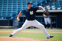 New York Yankees pitcher Joba Chamberlin #62, on rehab assignment for the GCL Yankees, delivers a pitch against the GCL Phillies at Steinbrenner Field on July 17, 2012 in Tampa, Florida.   GCL Phillies defeated the GCL Yankees 4-2.  (Mike Janes/Four Seam Images)
