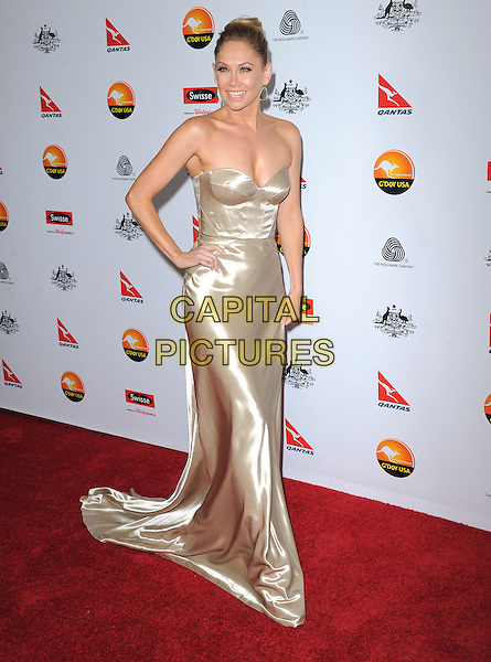 Kym Johnson.at The G'Day USA Black Tie Gala held at The JW Marriot at LA Live in Los Angeles, California, January 12th 2013.                                                                 .full length strapless gold dress hand on hip long maxi corset bustier .CAP/DVS.©Debbie VanStory/Capital Pictures.