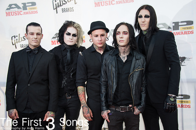 "Chris Motionless, Josh Balz, Ryan Sitkowski, Ricky Horror, and Devin ""Ghost"" Sola of Motionless In White attend the 2014 AP Music Awards at the Rock And Roll Hall Of Fame and Museum at North Coast Harbor in Cleveland, Ohio."