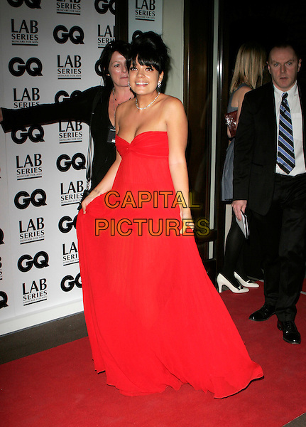 LILY ALLEN.Attending the 10th Anniversary GQ men Of The Year Awards, Royal Opera House, Covent Garden, London, England, September 4th 2007..magazine full length long red maxi dress strapless gown lifting holding skirt .CAP/AH.©Adam Houghton/Capital Pictures.