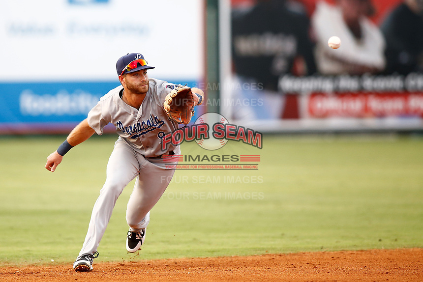 Pensacola Blue Wahoo short stop Taylor Featherston (9) fields a line drive during a game against the Chattanooga Lookout on July 27, 2018 at AT&T Field in Chattanooga, Tennessee. (Andy Mitchell/Four Seam Images)