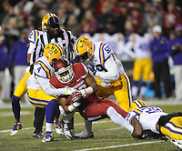 NWA Media/ANDY SHUPE - Arkansas' Jonathan Williams, center, is tackled by LSU's Kwon Alexander (4), Jermauria Rasco (59) and Jalen Mills (28) during the first quarter Saturday, Nov. 15, 2014, at Razorback Stadium in Fayetteville.