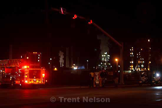 Fire crews set up outside of the Tesoro Refinery at 900 North 400 West after a large fire lit up the sky Wednesday, October 21 2009 in Salt Lake City.