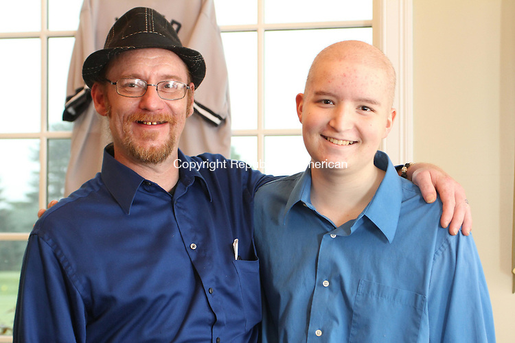 WATERTOWN, CT June 10 2014-061014LW01 - Jay Ralicki, left, and his son, Duncan Ralicki, 15, smile for a photo at the Joe Garassino 2nd Annual Golf Outing at the Watertown Golf Club Monday. The Joe Garassino Foundation gave $2,500 to the Ralickis. Duncan Ralicki, a sophomore at Watertown High School, is undergoing treatment for leukemia.<br /> Laraine Weschler Republican-American